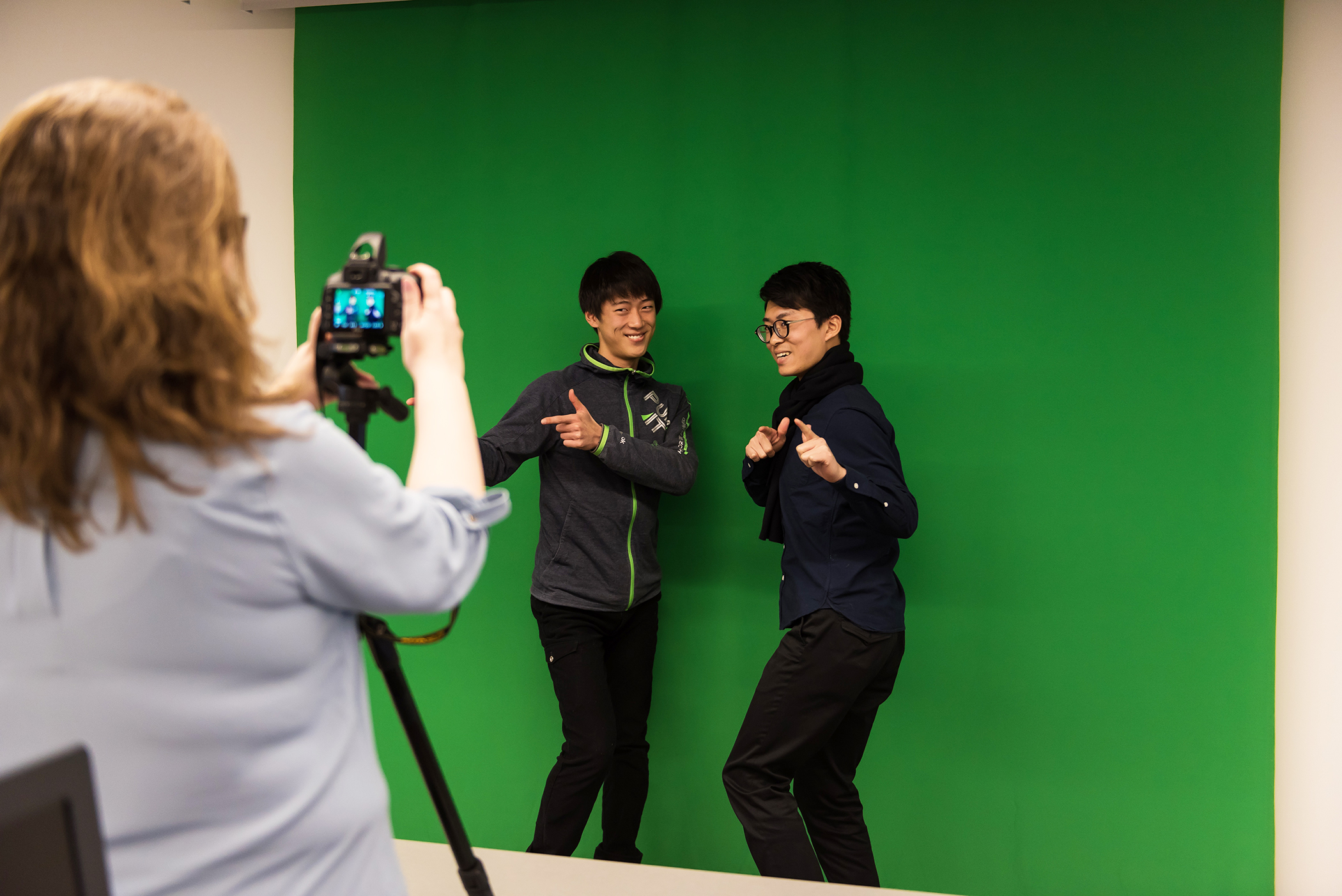 patrons using a green screen in The Lab