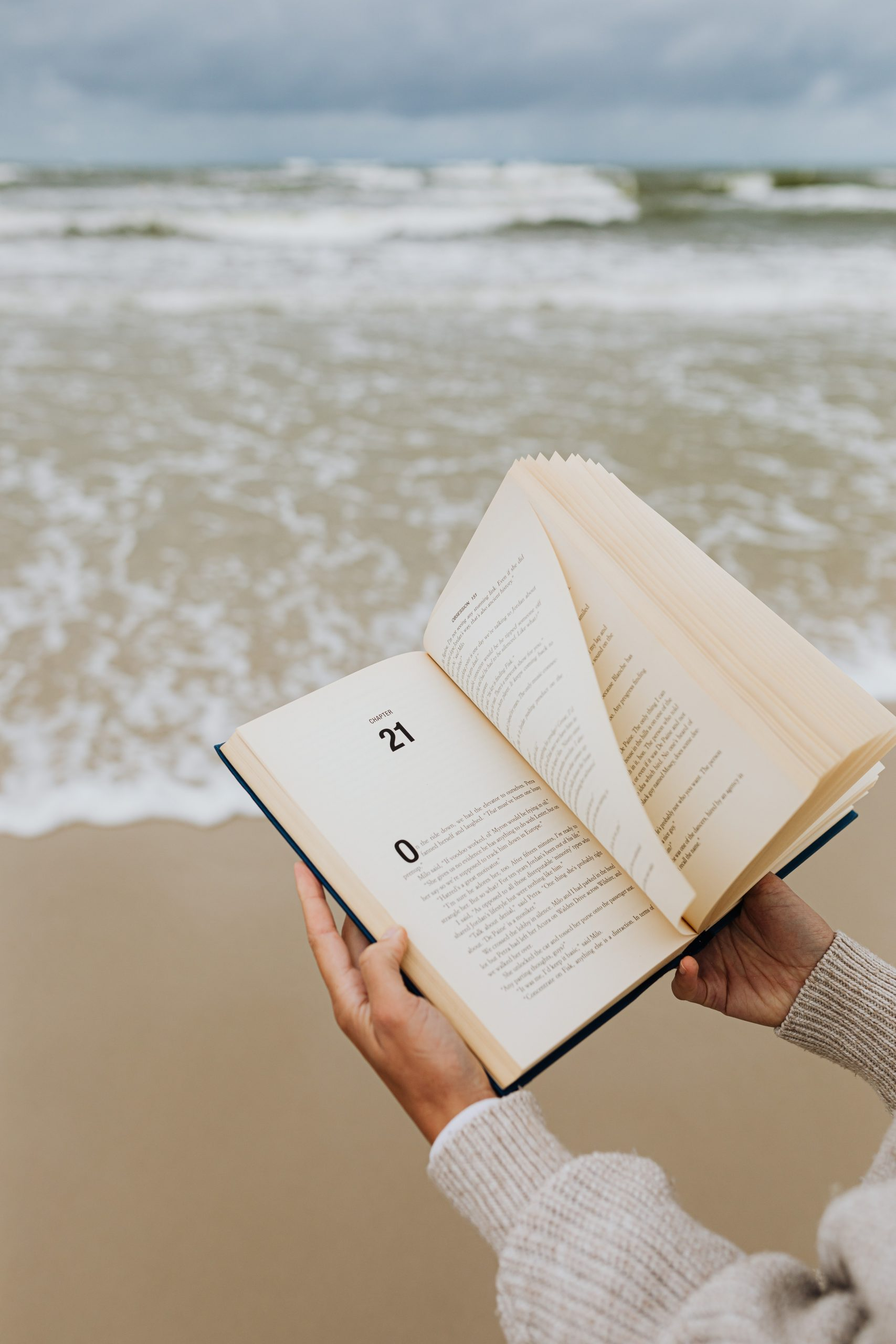 A book with ocean waves in the background