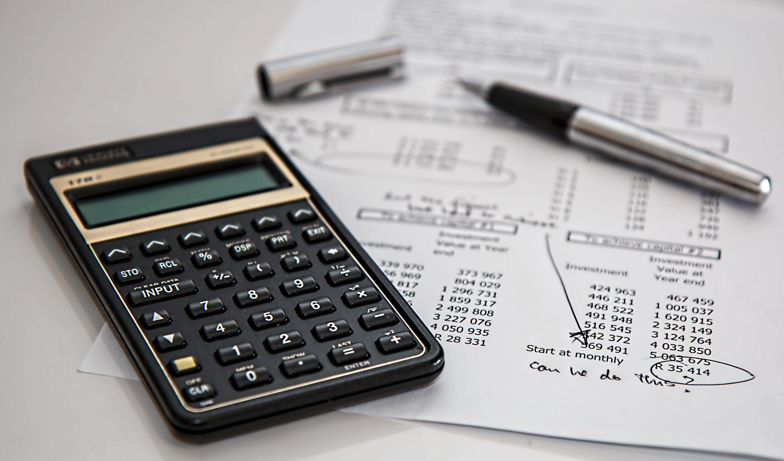 a calculator and spreadsheet for budgeting
