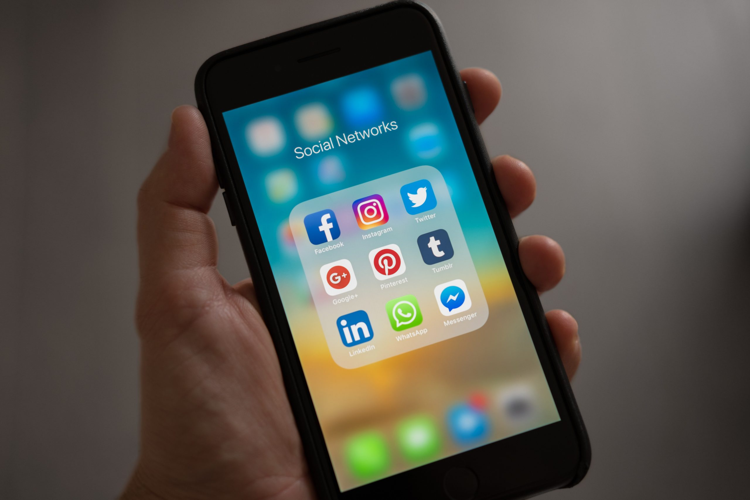 an iPhone with social networking apps