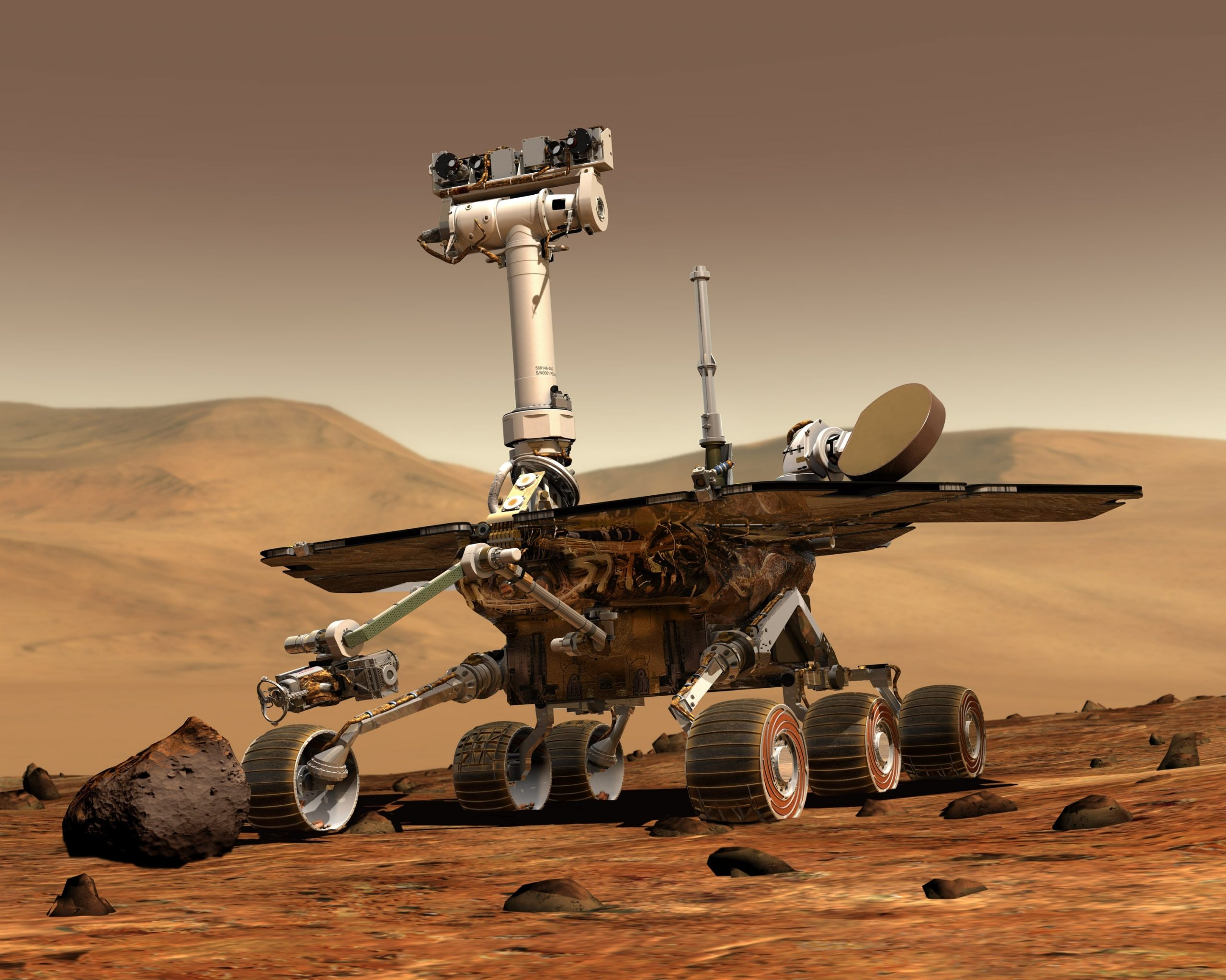 A rover studying a Mars rock outrcrop