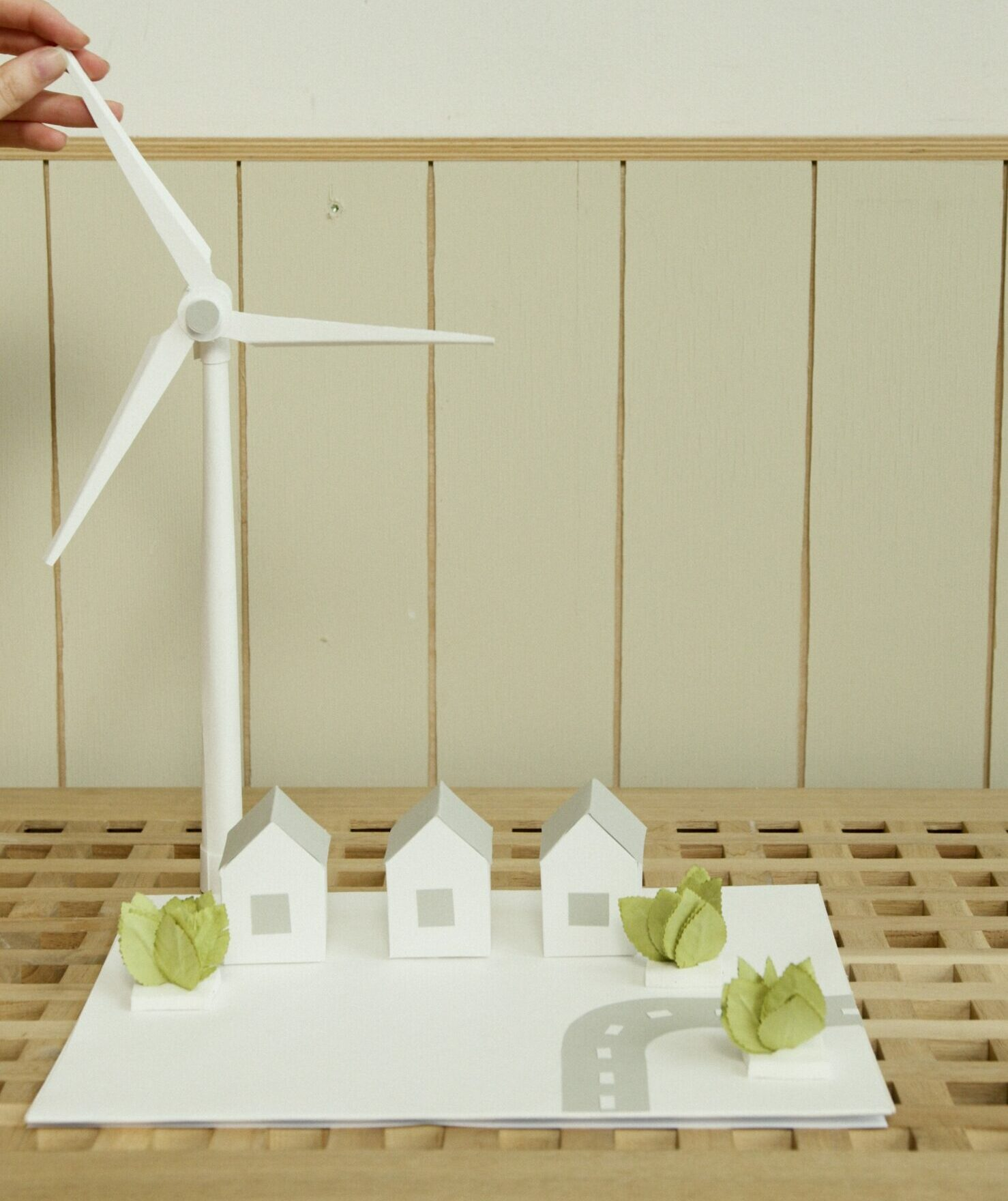 A paper model of several homes with a windmill.